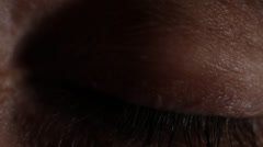 Macro of closed hazel eye opening and iris dilating as light turns on.1080p24. - stock footage
