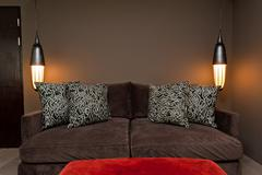 brown two seated sofa dark ambience - stock photo