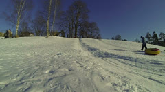 Children, slide, down, icy, hill Stock Footage