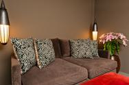 Stock Photo of brown two seated sofa dark ambience