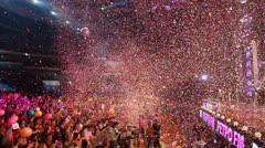 Panorama of hall with people and confetti fly during concert Stock Footage