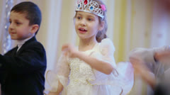 Stock Video Footage of Group of kids in holiday costumes dance during celebration