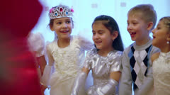 Children raise hands when play game during celebration Stock Footage