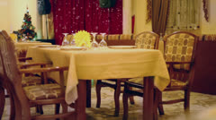 Empty holiday table at background of chrsitmas tree Stock Footage
