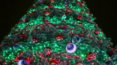 Garland lamps flash on christmas tree with toy balls and bells Stock Footage