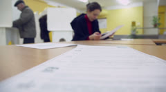Ballot list lies on table with woman which reads Stock Footage