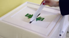 Woman puts ballot in chink of box with Bulletin inscription Stock Footage