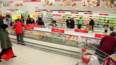 People buy food at Auchan store in shopping center Troika Stock Footage
