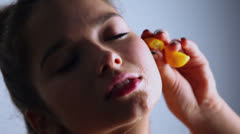 Juice on face of young model which holds fruit, closeup - stock footage