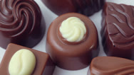 Stock Video Footage of Several different chocolate candies circling, closeup