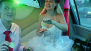 Stock Video Footage of Newlyweds clink glasses with alcohol during ride at car