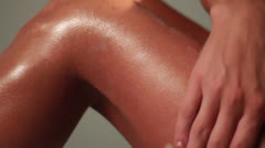Woman Applies Sun Screen Tan Lotion by Messaging Her Hands Over Lady Body Parts - stock footage
