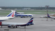 Stock Video Footage of Passengers airliners and service cars ride at airdrome
