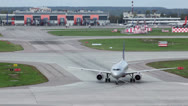 Stock Video Footage of Aircraft turns on runway at airport with service car traffic