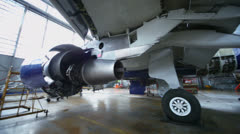 Disassembled turbine of aircraft under repair in hangar - stock footage