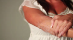 Woman Applies Sun Screen Tan Lotion by Messaging Her Hands Over Lady Body Parts Stock Footage