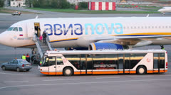 Passengers come out from plane in Sheremetyevo Stock Footage