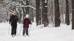 Two children skiing towards camera at winter Stock Footage
