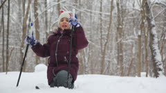 Cute little girl sitting in one knee in snow - stock footage