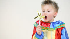 Little boy in costume with a windmill isolated on white Stock Footage