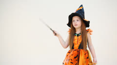 Little girl embodies a witch moving her hand enchanting Stock Footage
