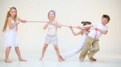 Four cute kids in white clothes and pink rope isolatd on white Stock Footage
