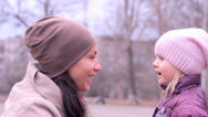 Stock Video Footage of girl with the child, are turned, talk, laugh