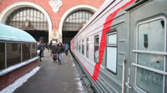 People moving on platform and train arriving in Kazansky station Stock Footage