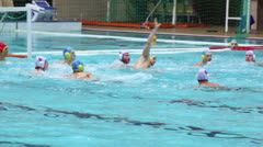 Men play water polo unsuccessful attack to gate Stock Footage