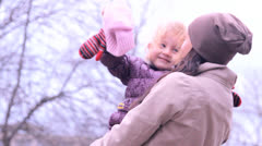 Girl with the child, are turned, talk, laugh Stock Footage