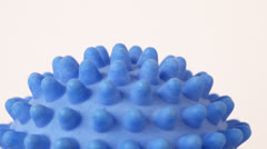 Blue spiky ball - toy for dogs on white background, zoom - stock footage