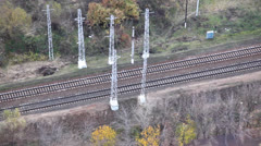 Train moving on tracks seen from above at day Stock Footage