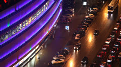 Illuminated street with traffic during the night Stock Footage