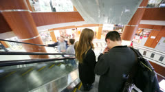 People moving by escalator in Schuka Mall Stock Footage