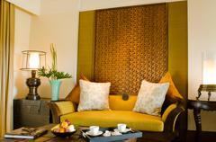 contemporary living area resort hotel suite room - stock photo