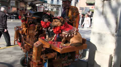 Old barrel organ with trained dogs Stock Footage