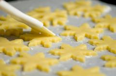 Glazing cookies before backing Stock Photos
