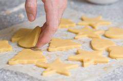 Placing cookies after cutting on backing paper Stock Photos