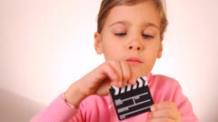 Cute little girl playing with keyring isolated on white Stock Footage
