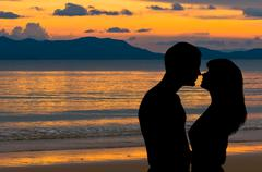 Couple in love at sunset Stock Photos