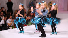 Four cute little girls dancing and singing on the stage Stock Footage