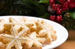 Decorated star shape christmas cookies Stock Photos