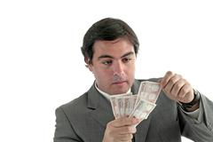 Stock Photo of business man with money over a white background