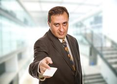 Stock Photo of young businessman with a card