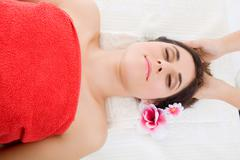 Beautiful young woman getting spa treatment Stock Photos