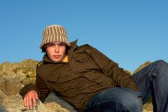 Relaxed young man portrait outdoor with a hat Stock Photos