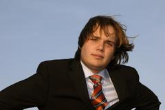 Portrait of a young business man, on blue sky Stock Photos