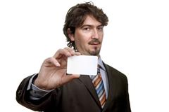 Stock Photo of young businessman with card, focus on the card