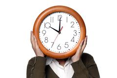 woman with a clock covering her head - stock photo