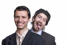 Stock Photo of two silly young men portrait on white, focus on the right man
